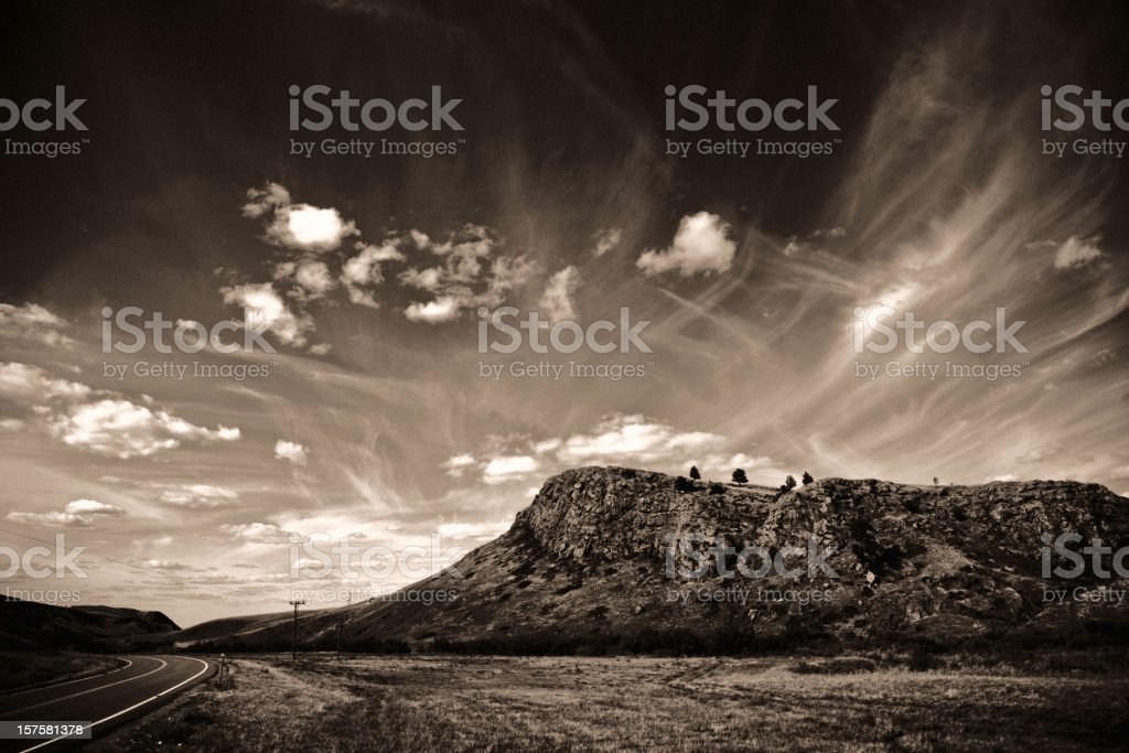 Rocky Hill Against Dramatic Sky royalty-free stock photo