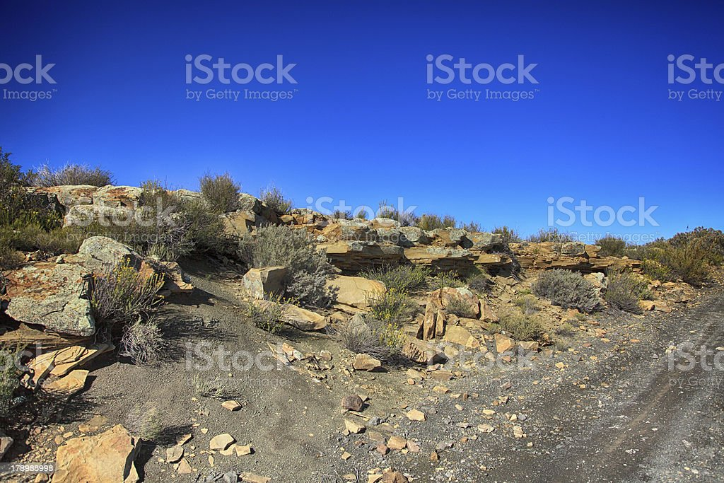Rocky hillside alongside a gravel road in the Northern Cape. royalty-free stock photo