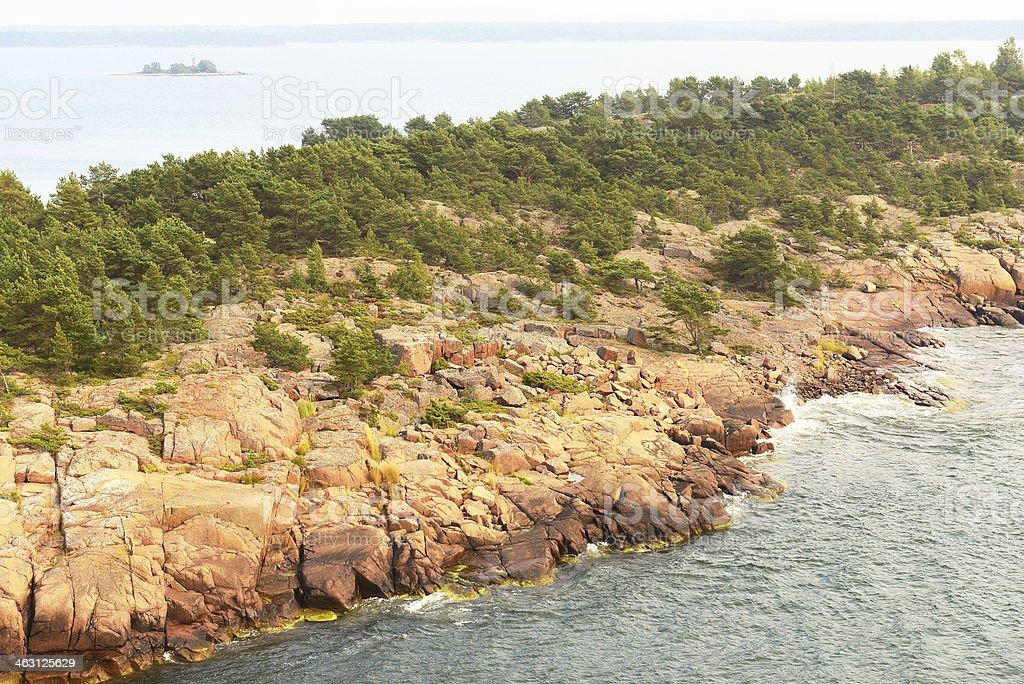 Rocky island in misty sea stock photo