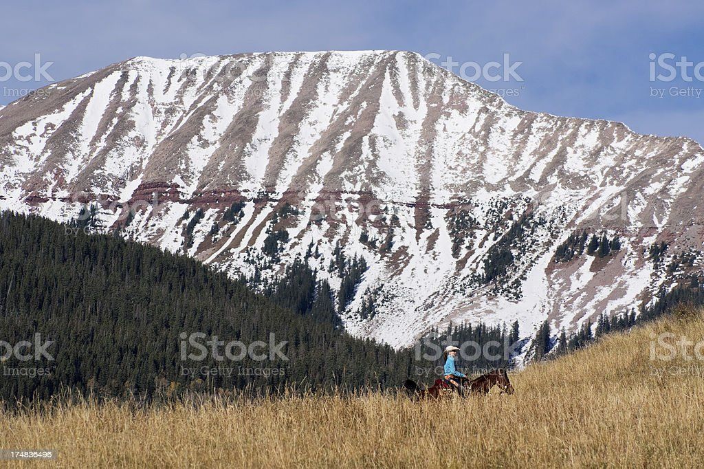 rocky mountain cowgirl landscape royalty-free stock photo
