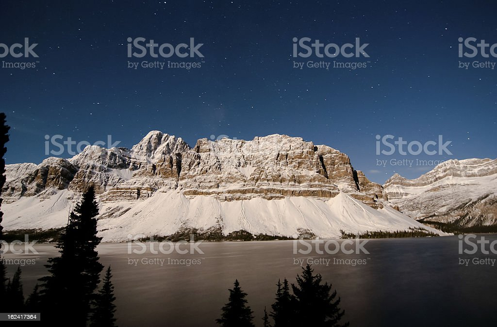 Rocky mountain in the moonlight stock photo