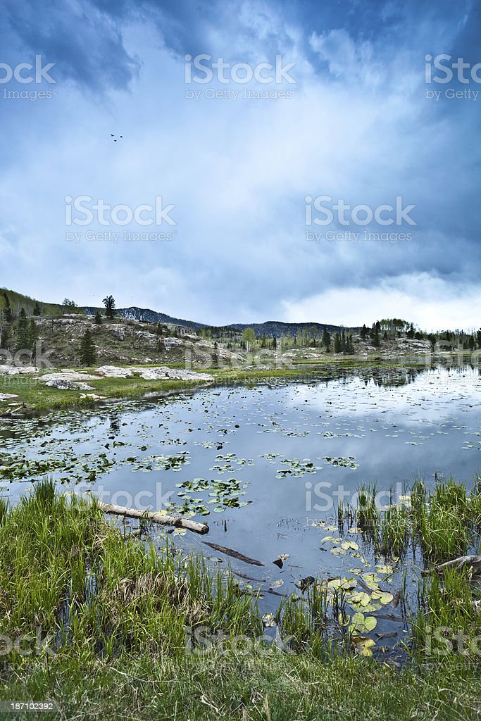 rocky mountain lake and sky stock photo
