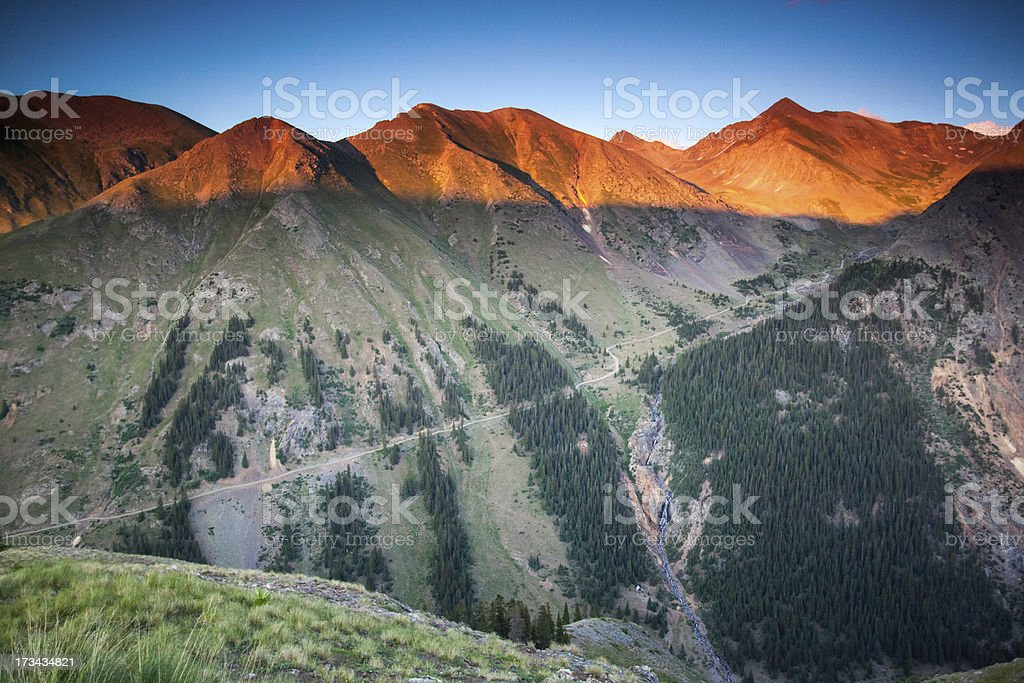 rocky mountain landscape sunset road stock photo