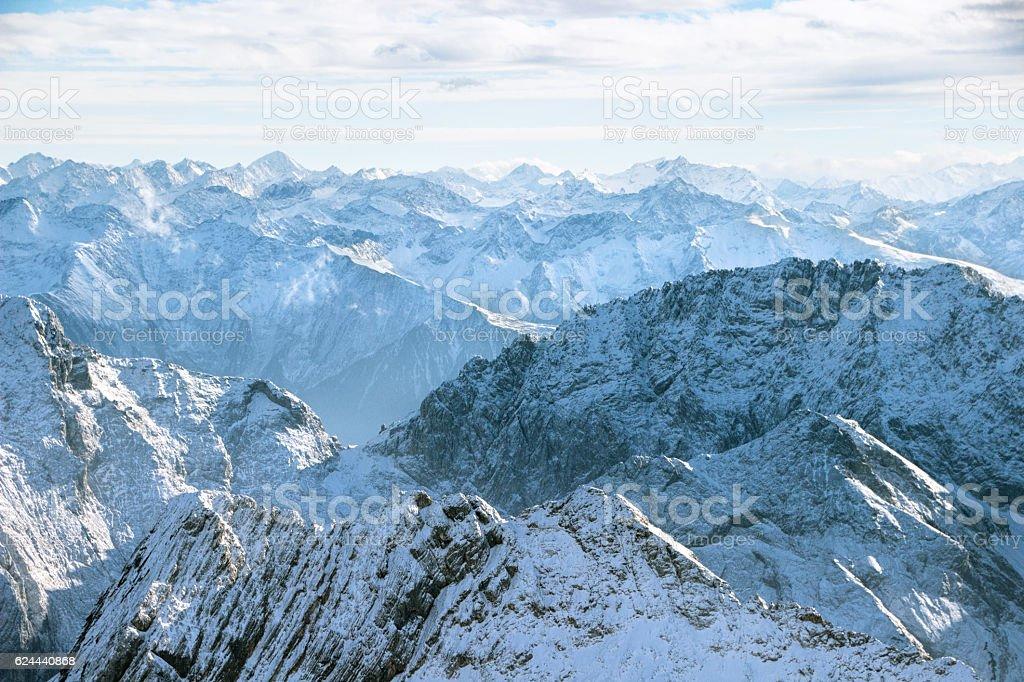 Rocky mountain range in snow stock photo