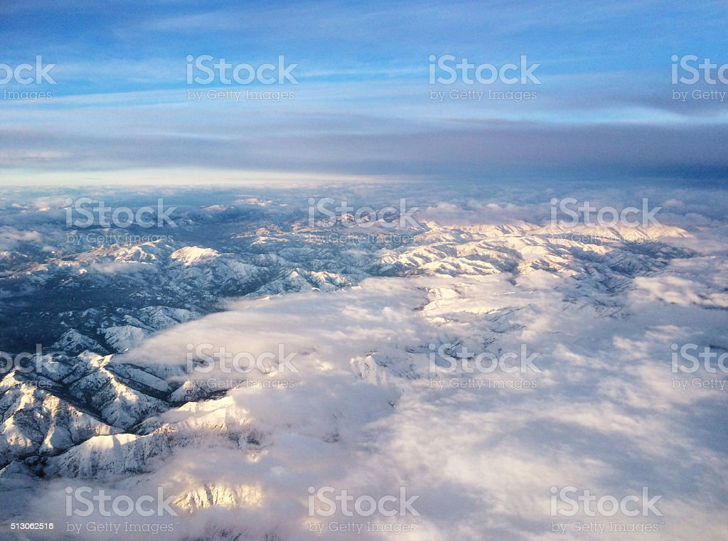 Rocky Mountains Aerial View from Airplane of Snow Capped Peaks stock photo