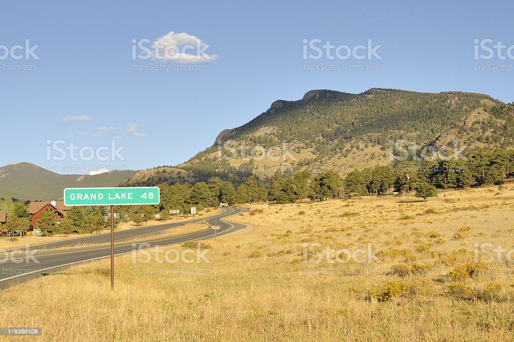 Rocky mountains in background, road signage to foreground stock photo