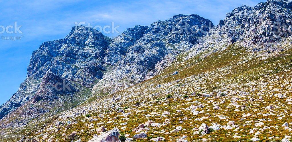 Rocky mountains on the coast at Gordon's Bay stock photo