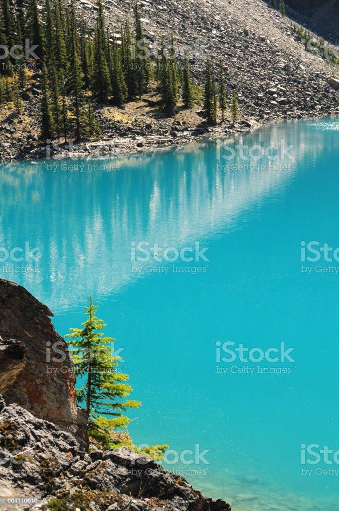 Rocky Mountains reflecting in Lake Moraine, Alberta, Canada. stock photo