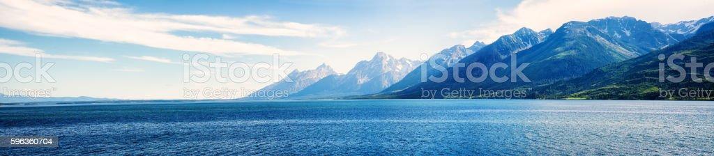 Rocky Mountains Teton range panorama with lake stock photo