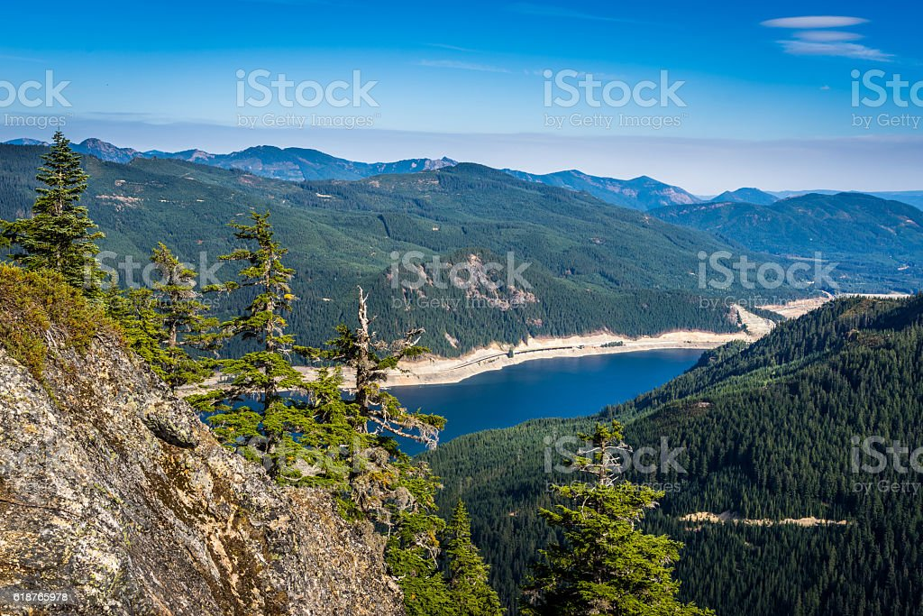 Rocky Mountains. The river in the valley. Green Forest. stock photo
