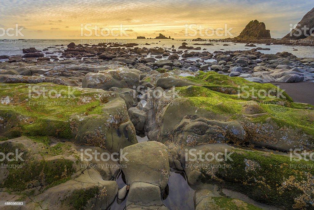 Rocky ocean coast with sunset stock photo