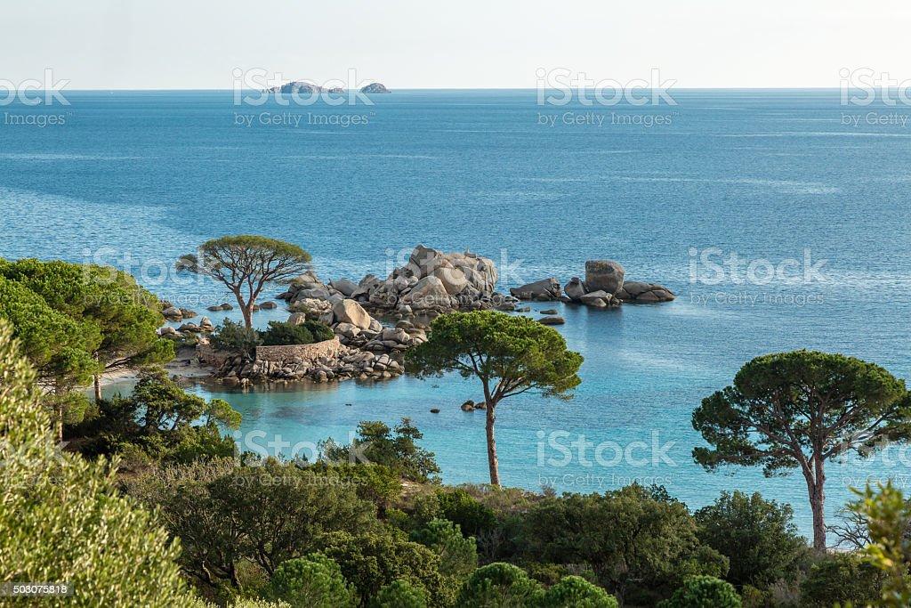 Rocky outcrop and coastline near Palombaggia in Corsica stock photo