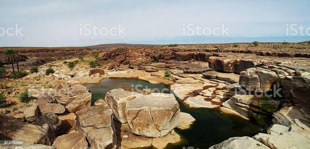 Rocky pond on Adrar plateau, Mauritania stock photo