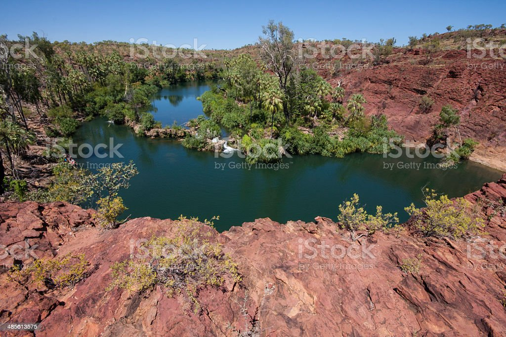 Rocky ridge and pool of water, Lawn Hill Gorge stock photo