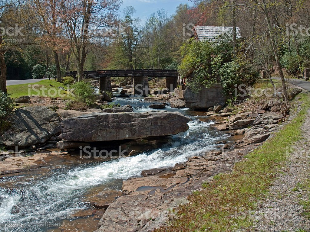 Rocky River and a Bridge royalty-free stock photo