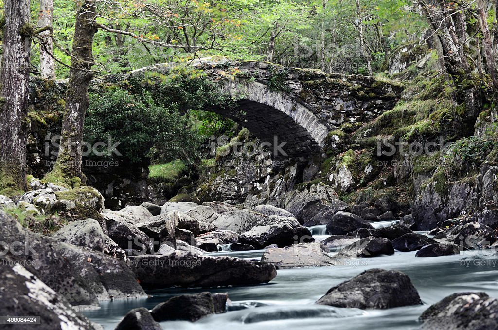 Rocky river bridge stock photo
