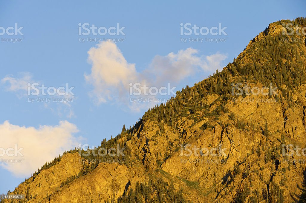 Rocky Rugged Mountains and Clouds at Sunset royalty-free stock photo