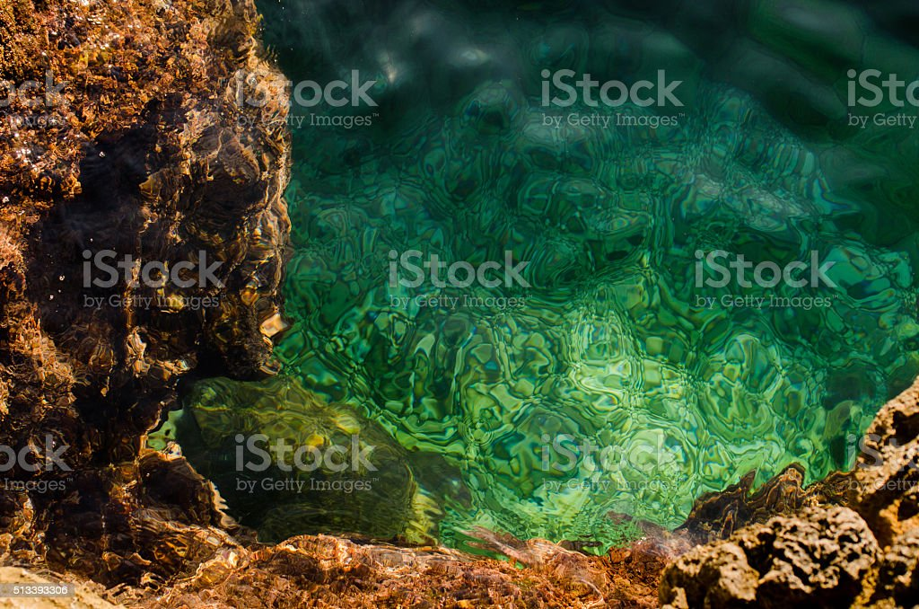 Rocky seabed under water with emerald seawater. stock photo