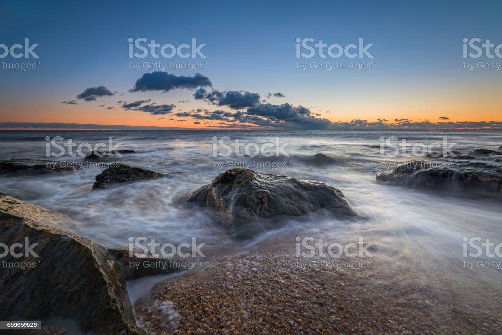 Rocky seascape sunrise in New Jersey stock photo