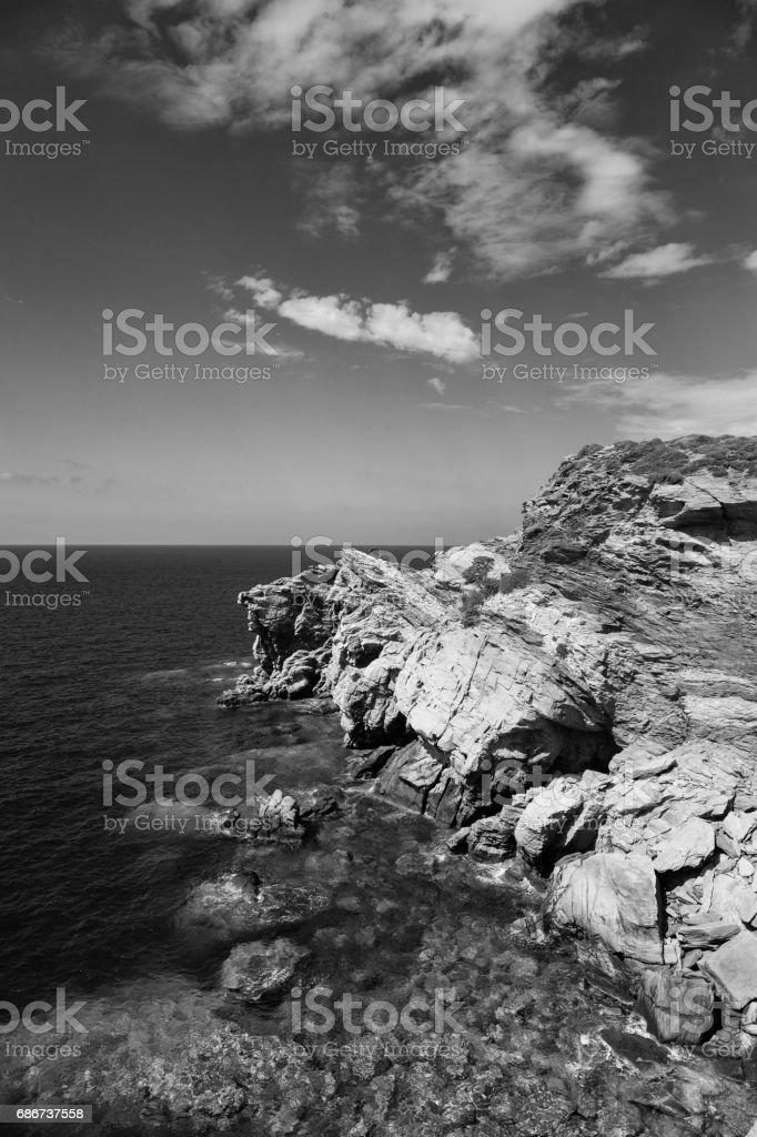 Rocky seashore of Crete Island in b&w, Greece stock photo
