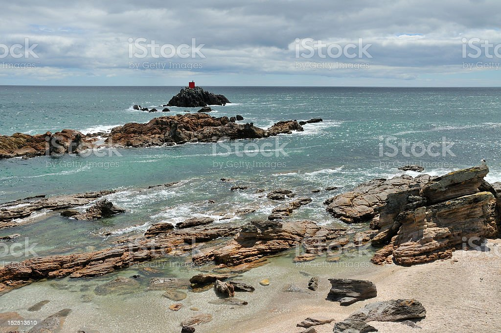 Rocky shore along Mt Manganui coastal walk, New Zealand royalty-free stock photo