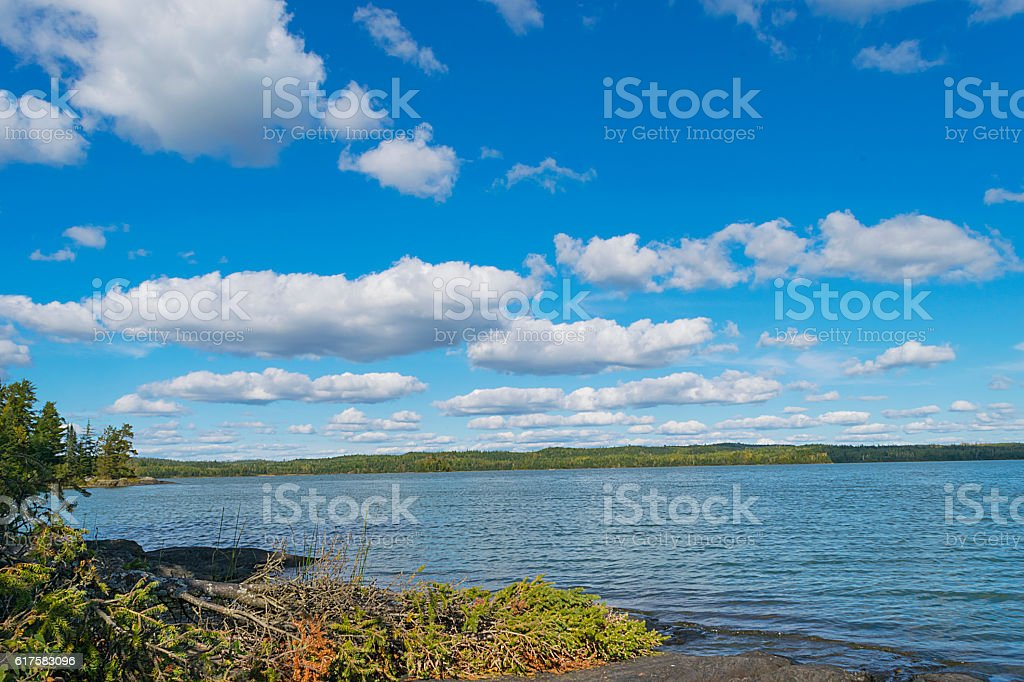 Rocky shore and beautiful sky of Moose Lake stock photo