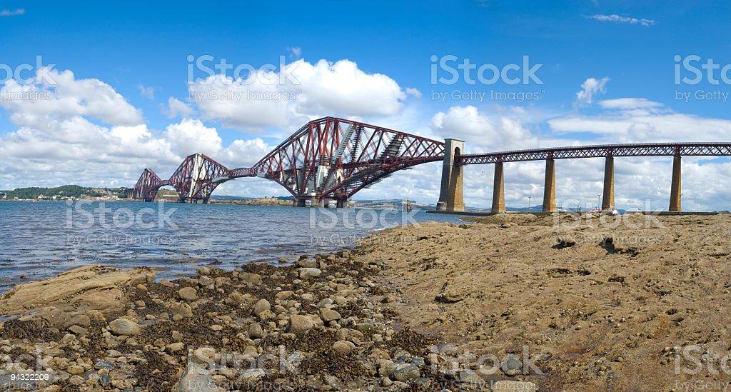 Rocky shore and bridge royalty-free stock photo