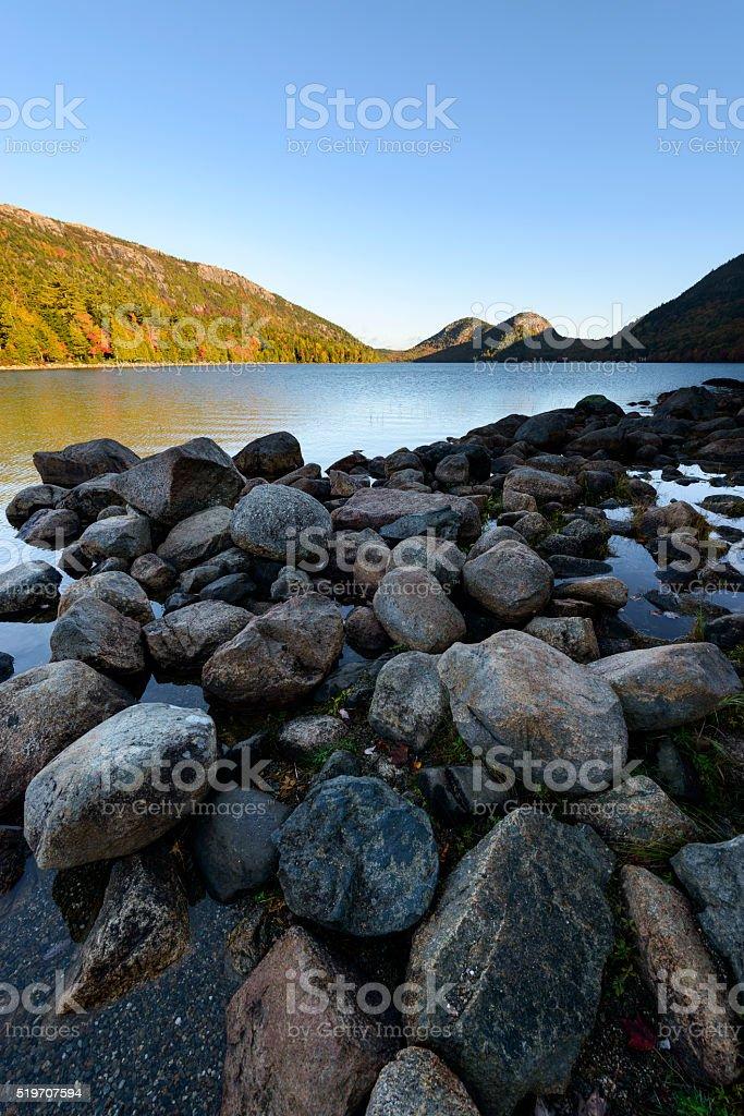Rocky Shore of Jordan Pond at Sunrise stock photo