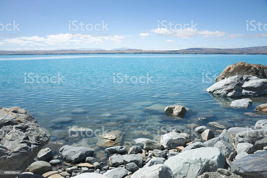Rocky shore of Lake Pukaki, South Island NZ stock photo