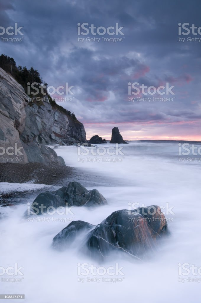 Rocky shore waves stock photo