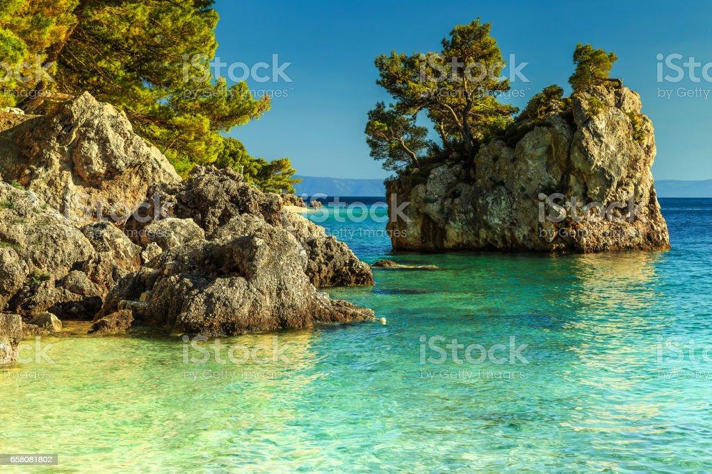 Rocky shore with crystal clear sea water, Brela, Dalmatia, Croatia stock photo