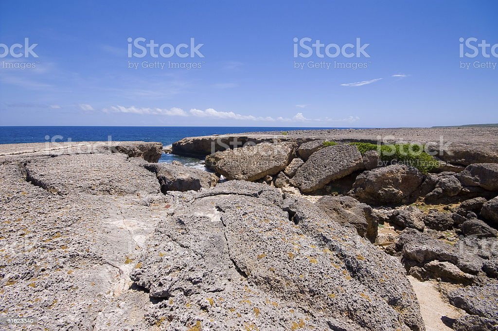 rocky shore with natural bridge collapsed stock photo