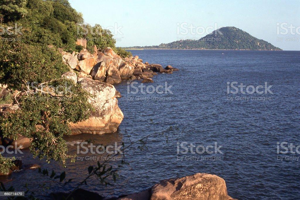 Rocky shoreline along Lake Malawi Malawi Africa stock photo