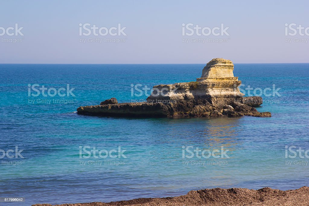 Rocky stacks on the coast of Salento in Italy stock photo
