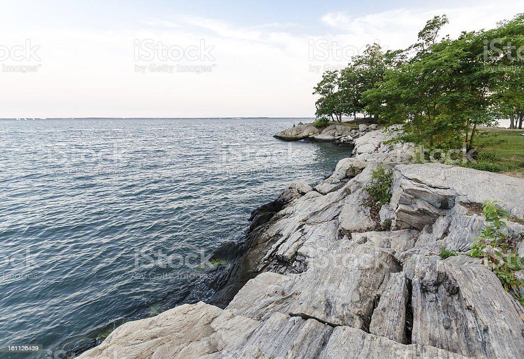 Rocky, tree-studded coast view stock photo