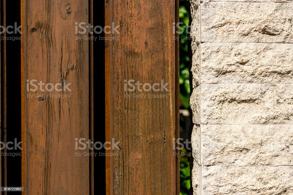 Rocky wall and planks stock photo