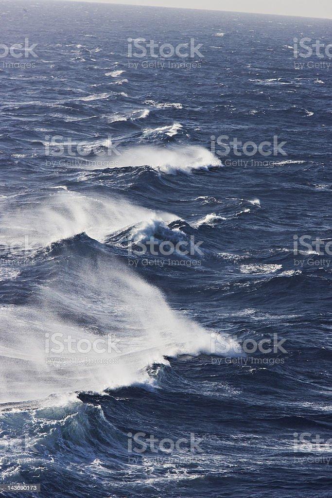 Rocky waves in ocean stock photo