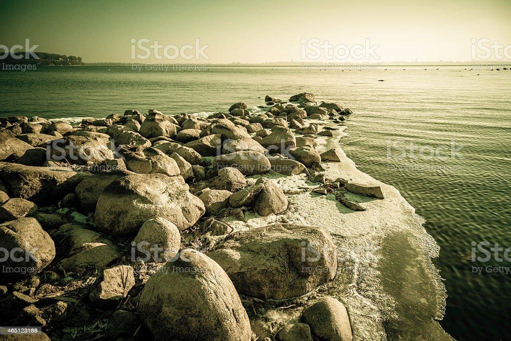 rocky winter shore stock photo