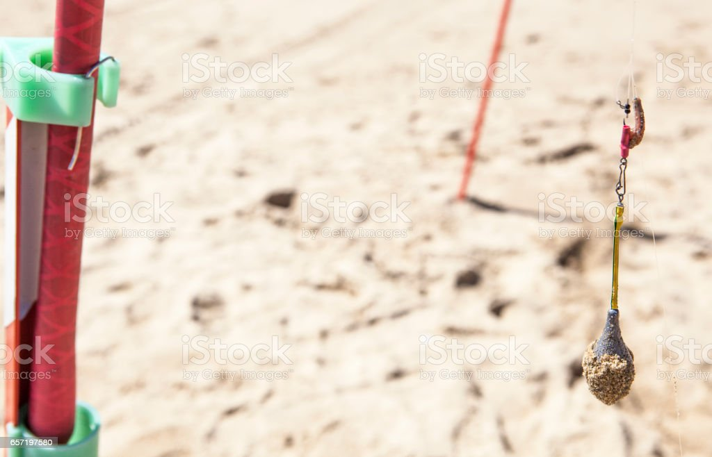 Rod stand with hanging bait and lead sinker stock photo