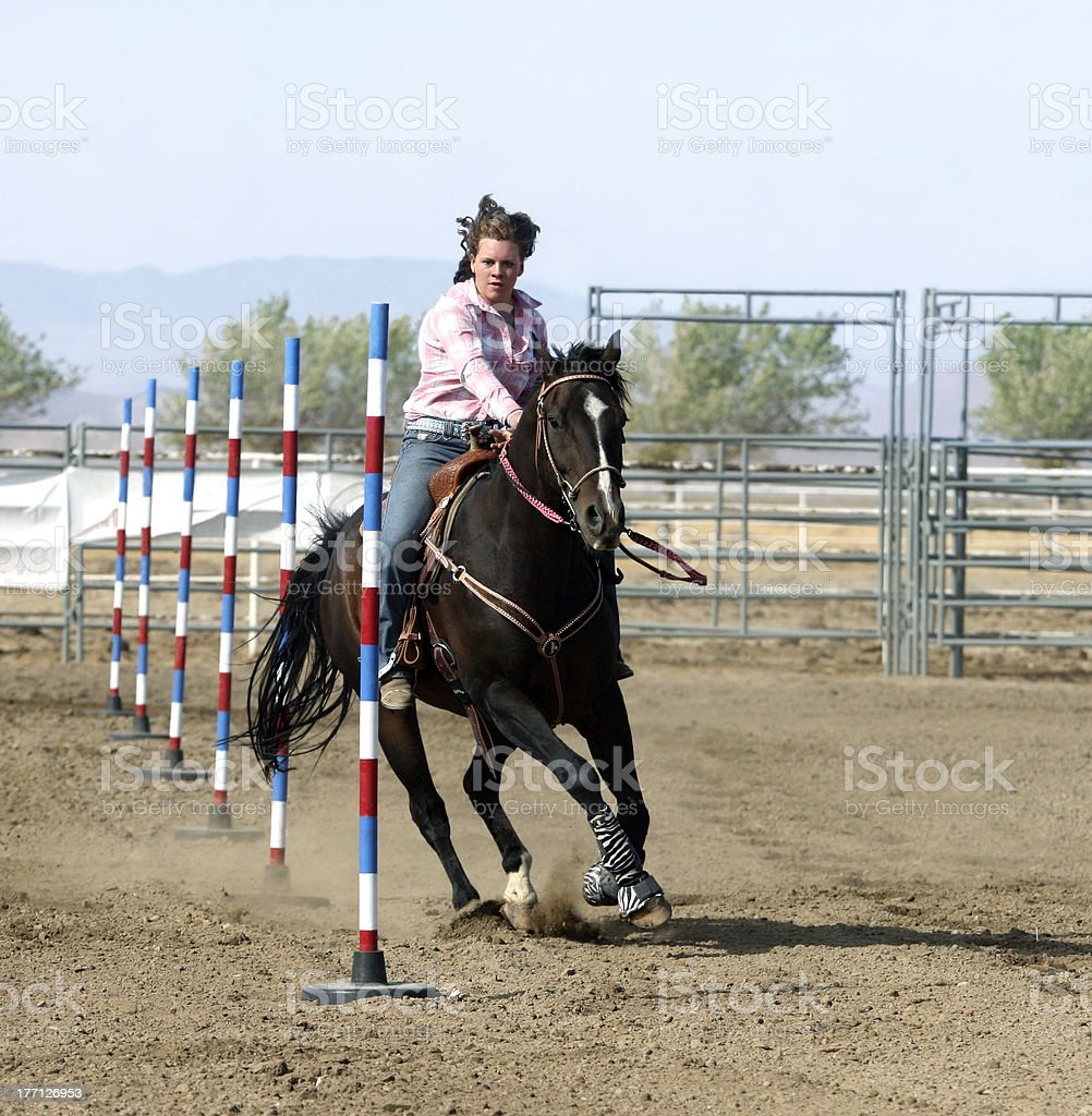 Rodeo Cowgirl Pole Racing with Photo Copy Space stock photo