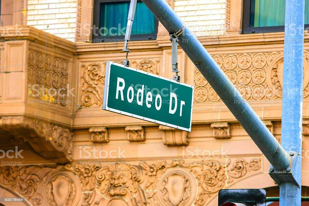 Rodeo Dr green and white street sign stock photo