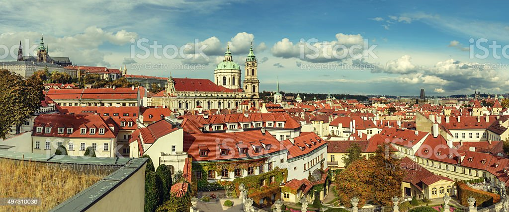Rofs of old Prague with church of St. Nicolas stock photo