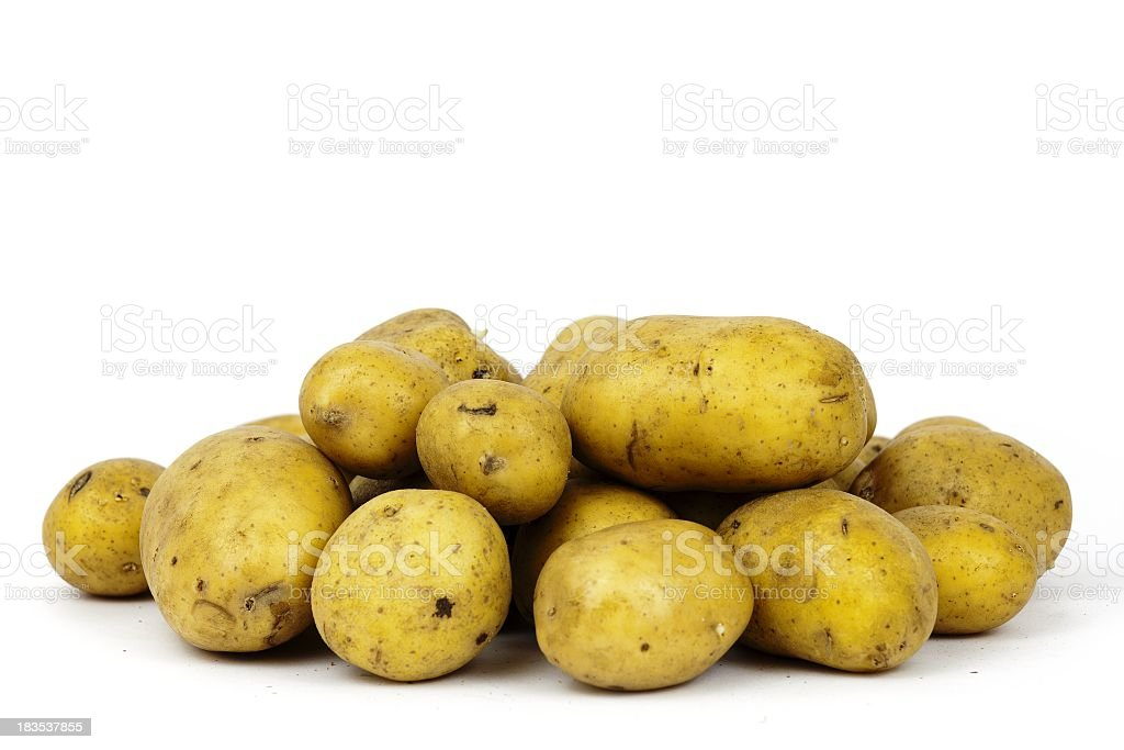 Roh Potatoes heap on white background stock photo