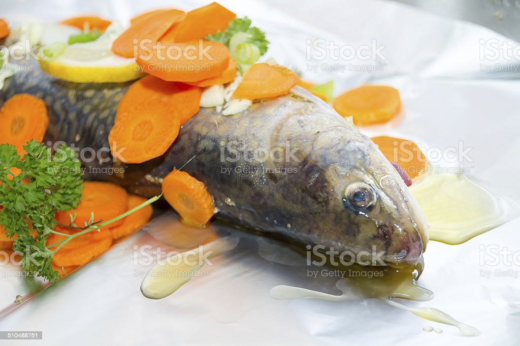 Roher Bachsaibling with lemon slices stock photo