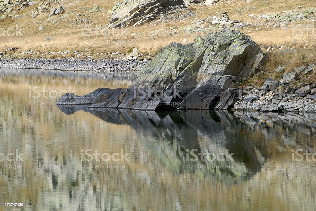 Roks on the lake stock photo