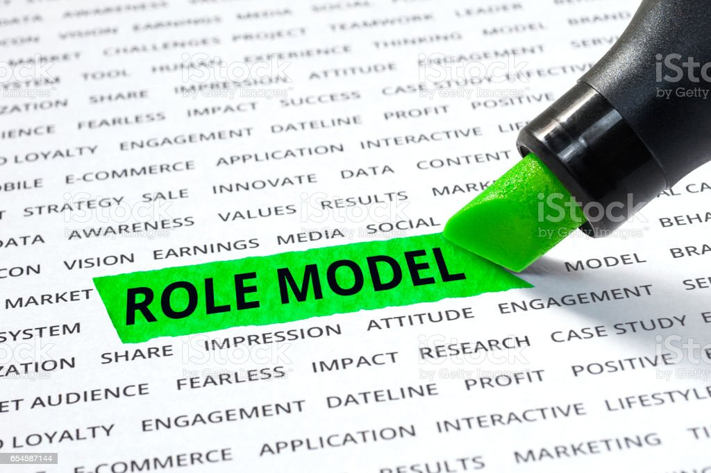 Role model word highlighted with marker on paper stock photo