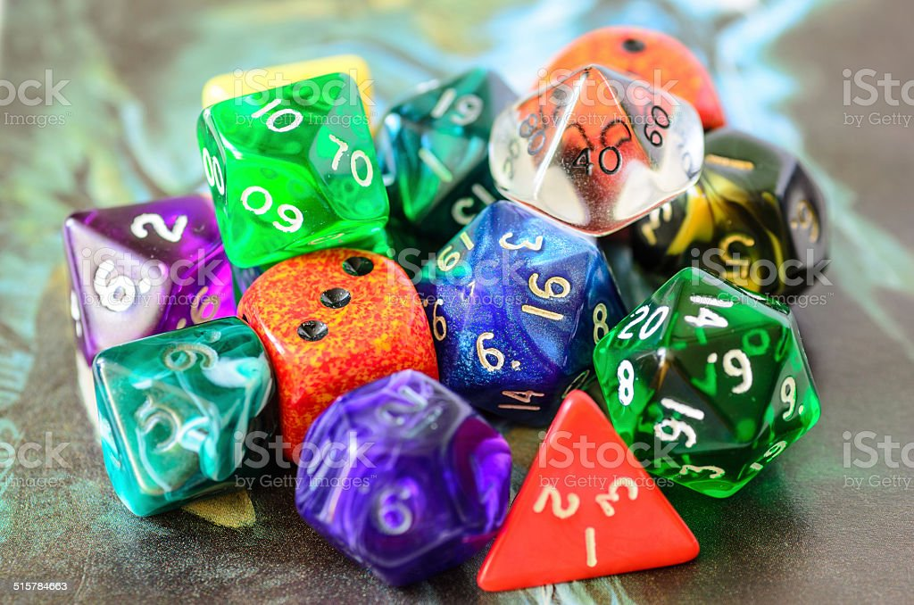 role playing dices lying on picture background stock photo