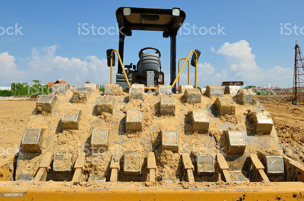 roll compactor attachment working at site stock photo
