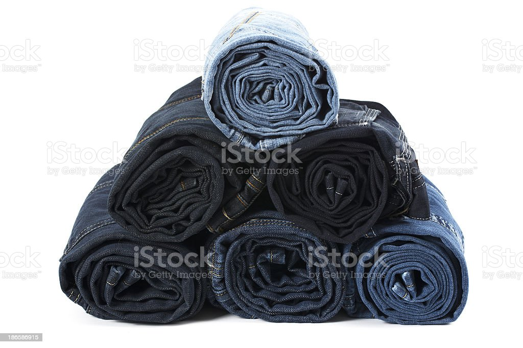 Roll denim jeans isolated on white royalty-free stock photo