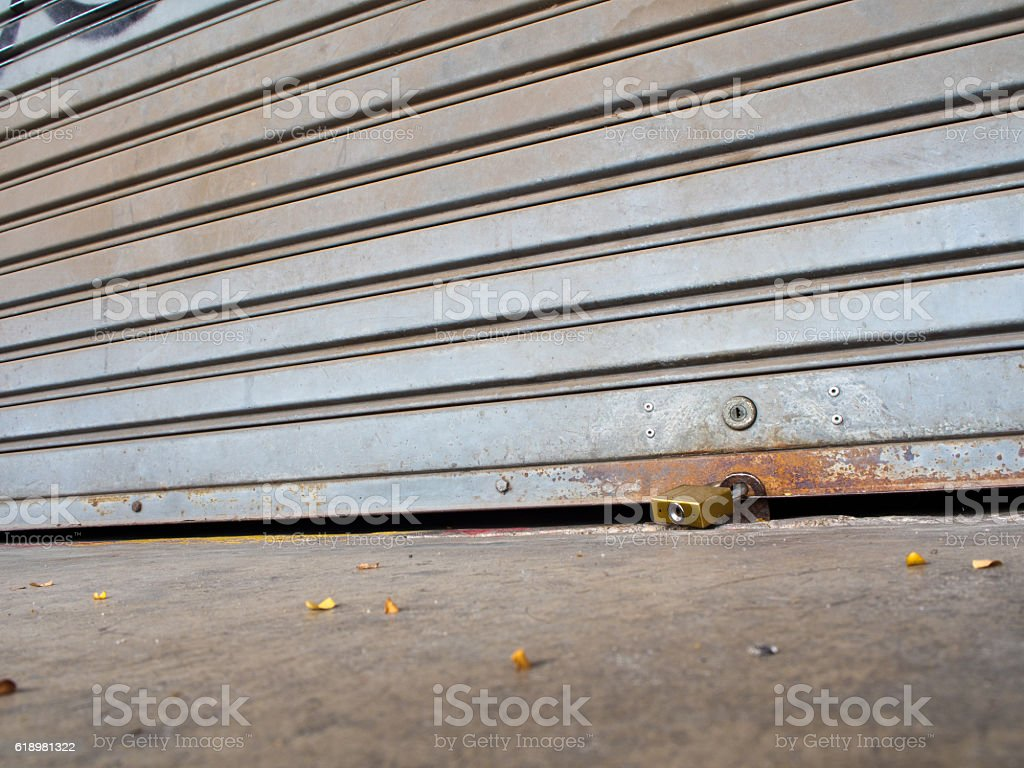 Roll garage gate is closed and locked stock photo